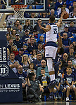 Nevada forward Trey Porter (15) blocks the shot of Akron's Loren Cristian Jackson (1) in the first half of an NCAA college basketball game in Reno, Nev., Saturday, Dec. 22, 2018. (AP Photo/Tom R. Smedes)