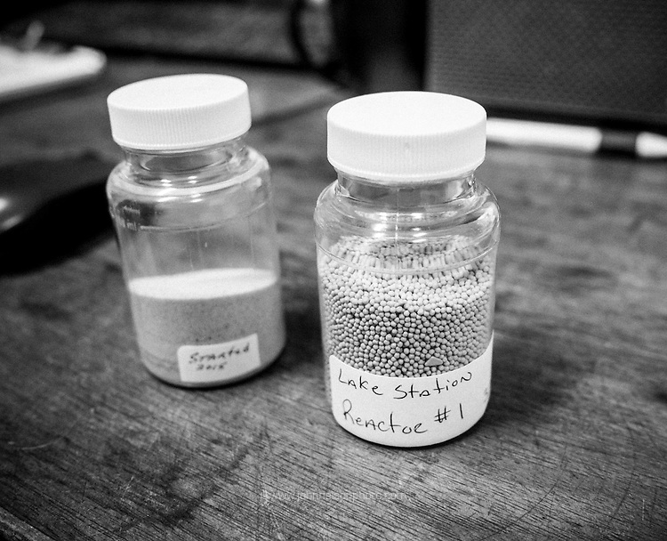 The Lake Station plant softens the raw well water using sand and sodium hydroxide. A chemical reaction draws the iron and manganese out of the water and onto the grains of sand. Foreground, grains of sand coated with the metals removed from the water.