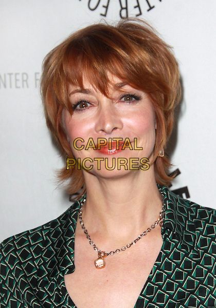 "SHARON LAWRENCE .27th Annual Paley Fest presents "" Curb Your Enthusiasm"" held at the Saban Theatre, Beverly Hills, California, USA, 14th March 2010..portrait headshot  green  print patterned pattern necklace .CAP/ADM/TC.©T.Conrad/Admedia/Capital Pictures"