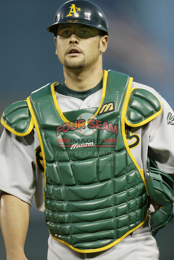 Ramon Hernandez of the Oakland Athletics during a 2002 MLB season game against the Los Angeles Angels at Angel Stadium, in Anaheim, California. (Larry Goren/Four Seam Images)