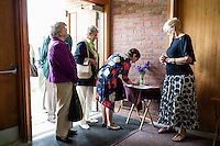 "Nancy Shilts (right) looks on as parishioners leave their thoughts in a notebook at St. Frances Xavier Cabrini Church in Scituate, Mass., on Sun., May 29, 2016. Shilts has been a member of the church since it opened in 1961, and her children were baptized there. Members of the congregation have been holding a vigil for more than 11 years after the Archdiocese of Boston ordered the parish closed in 2004. For 4234 days, at least one member of Friends of St. Frances X. Cabrini has been at the church at all times, preventing the closure of the church. May 29, 2016, was the last service held at the church after members finally agreed to leave the building after the US Supreme Court decided not to hear their appeal to earlier an Massachusetts court ruling stating that they must leave. The last service was called a ""transitional mass"" and was the first sanctioned mass performed at the church since the vigil began."