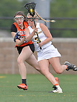 Minooka's Elizabeth Cullen (left) shadows O'Fallon's Brooke Thomas as she carries the ball downfield. O'Fallon played Minooka in a quarterfinal game of the O'Fallon sectional at O'Fallon Sports Park on Monday May 20, 2019. <br /> Tim Vizer/Special to STLhighschoolsports.com