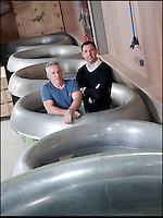 BNPS.co.uk (01202 558833)<br /> Pic: PhilYeomans/BNPS<br /> <br /> Bespoke furniture for the Jet Set.<br /> <br /> Shane(l) and Brett Armstrong in amongst some engine intakes awaiting transformation.<br /> <br /> Two brother's have come up with ultimate in aircraft recycling - turning unwanted bits of redundant airliners into highly desirable - and highly expensive - bespoke items of furniture.<br /> <br /> Brett and Shane Armstrong from Kent scour the worlds aircraft graveyards looking for interesting items they can rescue from sad decay and with a lot of imagination and elbow grease convert into one-off gleaming items of furniture costing thousands of pounds.