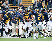 Mychal Kendricks of California celebrates with teammates after recovered a fumble during the game against ASU at Memorial Stadium in Berkeley, California on October 23rd, 2010.  California defeated Arizona State, 50-17.