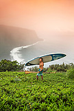 USA, Hawaii, The Big Island, paddle boarder stands above the Waipio Valley
