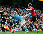 Daley Blind of Manchester United pushes over Sergio Aguero of Manchester City during the Barclays Premier League match at The Etihad Stadium. Photo credit should read: Simon Bellis/Sportimage