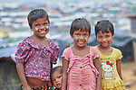 Rohingya children in the sprawling Kutupalong Refugee Camp near Cox's Bazar, Bangladesh. More than 600,000 Rohingya refugees have fled government-sanctioned violence in Myanmar for safety in this and other camps in Bangladesh.
