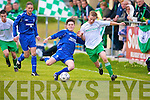 Killarney Athletic's Ryan O'Carroll and Killarney Celtic's Ant O'Leary.