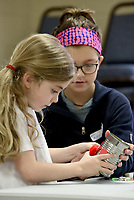 NWA Democrat-Gazette/DAVID GOTTSCHALK Makenzie Warren (right), a junior counselor, helps Charlotte Jackson, 5, with decorating her flower pot Wednesday, March 20, 2019, as they participate in Spring Break Camp at Mount Sequoyah in Fayetteville. The weeklong camp offers different themed activities each day that includes Detectives, Sports, Science/Tech along with free time activities. Campers can register for a day or multiple days.