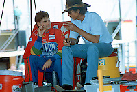 Jeff Gordon, left, talks with Richard Petty in the garage area at Talladega Superspeedway, Talladega, AL, May 1994. (Photo by Brian Cleary/www.bcpix.com)
