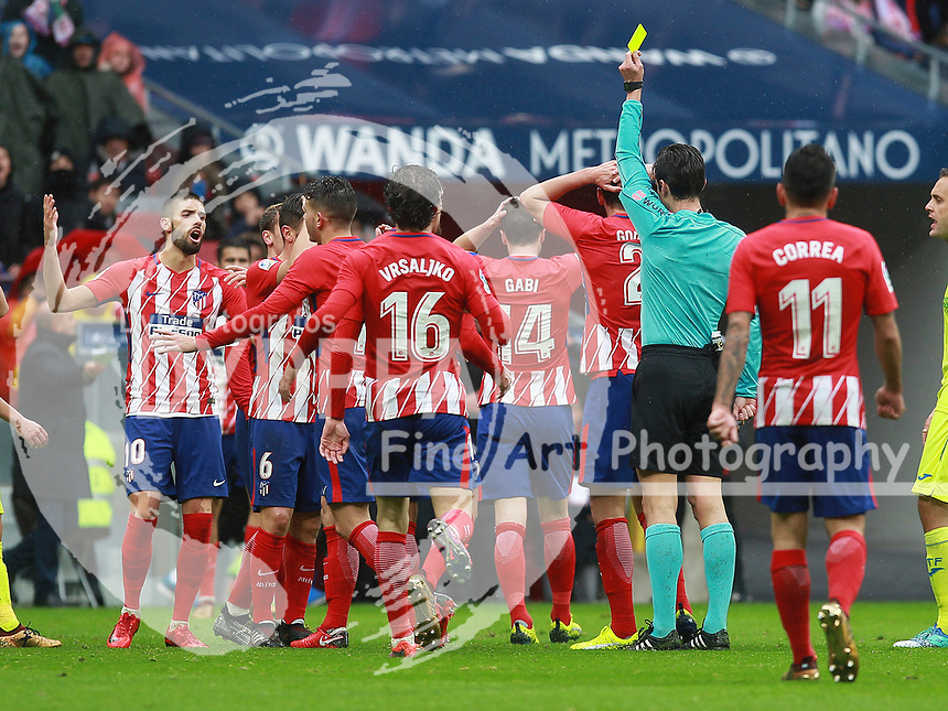 Atletico de Madrid's team argue with referee after yellow card<br /> <br /> Atletico de Madrid vs Getafe Spanish League football match, La Liga Santander, at Wanda Metropolitano stadium in Madrid on January 6, 2017