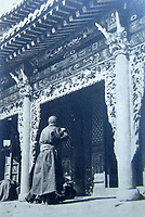 BNPS.co.uk (01202 558833)<br /> Pic: ClevedonAuctionRooms/BNPS<br /> <br /> Mongol Lama at his temple.<br /> <br /> Rev Francis John Griffith travelled as a Missionary aroud Outer Mongolia in the 1920's.<br /> <br /> A fascinating collection of early 20th century photos of Mongolia and China which were taken by a British vicar doing missionary work have been unearthed after 97 years.<br /> <br /> Through his famine relief work Reverend Francis John Griffith was able to get a remarkable insight into the lives of the native population and their nomadic existence.<br /> <br /> His encounters were captured using a handheld camera that he carried with him at all times.<br /> <br /> In one image a family goes about its business outside the hut that is their home, while another image is of a man riding a camel which was the typical method of transport.<br /> <br /> Revd Griffith was able to get native elders to sit for him in portraits and there are intimate snaps of women and children wearing elaborate native headdresses.<br /> <br /> As well as the people, Revd Griffith took an interest in the surroundings and photographed temples and prominent buildings in addition to the vast, desert landscape.
