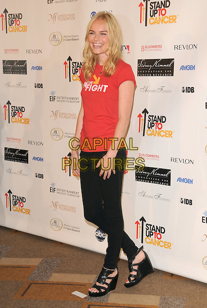 KATE BOSWORTH .Attending Stand Up To Cancer held at The Kodak Theatre in Hollywood, California, USA, September 05 2008.                                                                     .full length red In the Fight slogan t-shirt jeans trousers  black wedges shoes gladiator feet .CAP/DVS.©Debbie VanStory/Capital Pictures