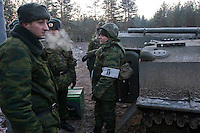 Kamenka, Karelia, Russia, 14/12/2007..Professional Russian soldiers with their armoured personnel carrier Snezhinka [Snowflake] 2007, a joint live fire training exercise for Russian and Swedish motorised infantry in which they play the roles of a combined peace-keeping force enforcing a demilitarised zone in a warring region.