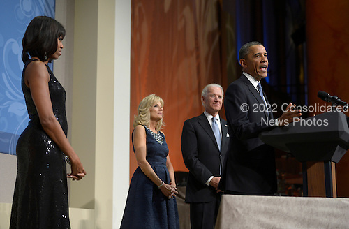 United States President Barack Obama, with First Lady Michelle Obama, Vice President Joseph Biden and Jill Biden,  delivers remarks at the Inaugural Reception at the National Building Museum in Washington, DC, USA, 20 January 2013. Obama defeated Republican candidate Mitt Romney on Election Day 06 November 2012 to be re-elected for a second term..Credit: Shawn Thew / Pool via CNP