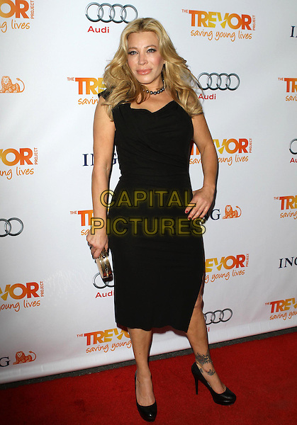 Taylor Dayne.Trevor Live at The Hollywood Palladium in Hollywood, California, USA..December 4th, 2011.full length black dress hand on hip.CAP/ADM/KB.©Kevan Brooks/AdMedia/Capital Pictures.