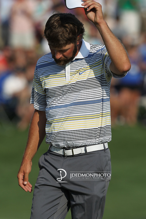 May 8,2011 - Lucas Glover acknowledges the gallerys' cheers after his finish on 18.  Lucas Glover wins the tournament in sudden death over Jonathan Byrd at Quail Hollow Country Club,Charlotte,NC.