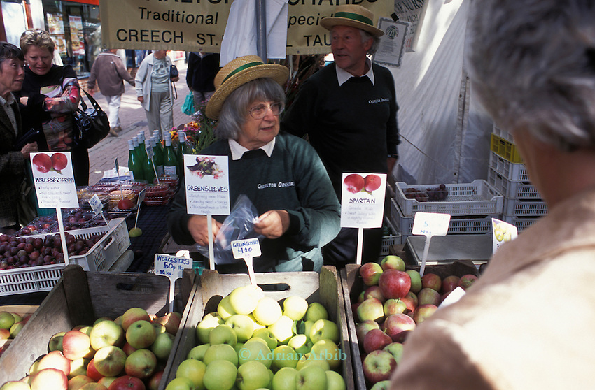 June and Robin Small's company, Charlton Orchards, Taunton, Somerset - seen here at  their Taunton Farmers Market Stall.  Their company was chewed up and spat out by the superstores, but they didn't give up. They found a way of surviving, by selling direct to local people. They've become evangelists for community orchards and local marketing.   They're growing about 25 varieties of English apple: one of the last diverse commercial orchards left in Britain.