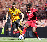 Liverpool's Divock Origi under pressure from  Wolverhampton Wanderers' Matt Doherty<br /> <br /> Photographer Rich Linley/CameraSport<br /> <br /> The Premier League - Liverpool v Wolverhampton Wanderers - Sunday 12th May 2019 - Anfield - Liverpool<br /> <br /> World Copyright © 2019 CameraSport. All rights reserved. 43 Linden Ave. Countesthorpe. Leicester. England. LE8 5PG - Tel: +44 (0) 116 277 4147 - admin@camerasport.com - www.camerasport.com