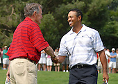 Bethesda, MD - July 4, 2007 -- Former United States President George H. W. Bush greets Tiger Woods at the 16th hole during the inaugural Earl Woods Memorial Pro-Am Tournament, part of the AT&T National PGA Tour event, Wednesday, July 4, 2007, at the Congressional Country Club in Bethesda, Maryland.  Woods donated 30,000 tournament tickets to military personnel to attend the event honoring soldiers and military families. .Credit: Molly A. Burgess - DoD via CNP.