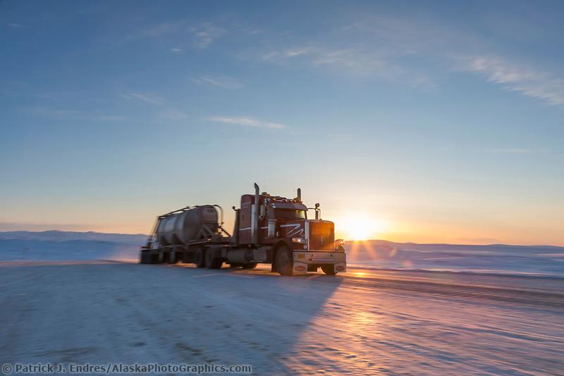 Truck drives the James Dalton Highway in Alaska's Arctic.