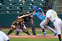 Tennessee Smokies outfielder Albert Almora (6) lays down a bunt base hit in front of catcher Justin O'Conner and umpire Alex Ransom during a game against the Montgomery Biscuits on May 25, 2015 at Riverwalk Stadium in Montgomery, Alabama.  Tennessee defeated Montgomery 6-3 as the game was called after eight innings due to rain.  (Mike Janes/Four Seam Images)