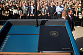 United States President Donald J.Trump's remarks sit on a podium during a ceremony to commemorate the September 11, 2001 terrorist attacks, at the Pentagon in Washington, D.C., U.S., on Monday, Sept. 11, 2017. Trump is presiding over his first 9/11 commemoration on the 16th anniversary of the terrorist attacks that killed nearly 3,000 people when hijackers flew commercial airplanes into New York's World Trade Center, the Pentagon and a field near Shanksville, Pennsylvania. <br /> Credit: Andrew Harrer / Pool via CNP