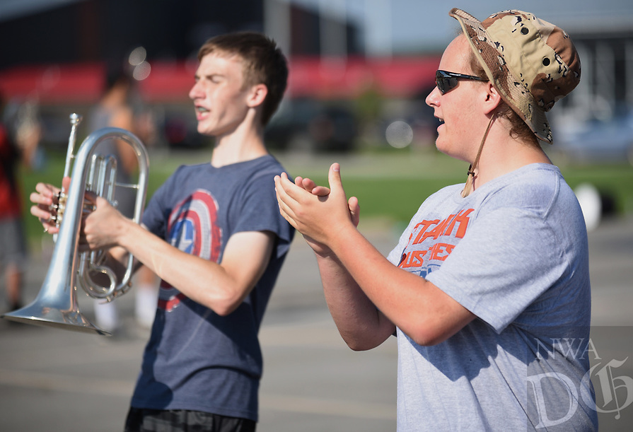 NWA Democrat-Gazette/DAVID GOTTSCHALK Zack Anderson (right) , a senior and assistant drum major with the Farmington High School Marching Band, leads a drill Monday, August 5, 2019, during practice at the school in Farmington. The 76 member marching band is preparing for their first performance during the home opening football game against Prairie Grove High School.