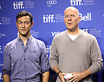 Joseph Gordon-Levitt, Bruce Willis attending the The 2012 Toronto International Film Festival Photo Call for 'Looper' at the TIFF Bell Lightbox in Toronto on 9/6/2012