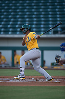 AZL Athletics first baseman Alonzo Medina (12) follows through on his swing during an Arizona League game against the AZL Cubs 1 at Sloan Park on June 28, 2018 in Mesa, Arizona. The AZL Athletics defeated the AZL Cubs 1 5-4. (Zachary Lucy/Four Seam Images)
