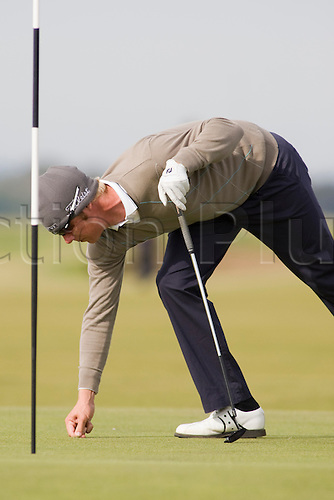 05 Oct 2009; St Andrews Scotland: Mikko Ilonen (FIN) repairs a divot while competing at The Old Course during the final round of the Alfred Dunhill Links Champions, part of the PGA European Tour, Race to Dubai Championship: Mandatory Credit Mitchell Gunn/actionplus