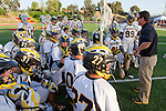 Mission Viejo, CA 05/11/11 - Coach Jon Fox addresses his team before the start of their game against  St Margaret at Mission Viejo High School for the 2011 CIF Southern Section South Division Championship.  Foothill defeated St Margaret 15-10.