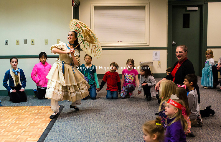 """Southbury, CT- 18 November 2016-111816CM01-  Anna Romano portrays """"Clara"""" during a preview of Woodbury Main Street Ballet's """"The Nutcracker"""" at the Southbury Public Library on Friday.  The production will run at Pomperaug High School December 3rd and 4th.    Christopher Massa Republican-American"""