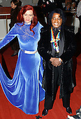 Musician James Brown and his wife, Tomi Rea, pose for photographers as they arrive at the John F. Kennedy Center for the Performing Arts gala, December 7, 2003 in Washington, DC.  Brown joins actress Carol Burnett , singer Loretta Lynn , director Mike Nichols and violinist Izthak Perlman as the 2003 Kennedy Center Honorees for their lifetime achievements in the arts.