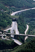 Nr Sarajevo, Bosnia and Herzegovina. High view of a road conjunction; cars; hills; forest.