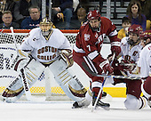 Brian Boyle (Boston College - Hingham, MA)battles with Ryan Maki (Harvard University - Shelby Township, MI) in front of Cory Schneider (Boston College - Marblehead, MA). The Boston College Eagles defeated the Harvard University Crimson 3-1 in the first round of the 2007 Beanpot Tournament on Monday, February 5, 2007, at the TD Banknorth Garden in Boston, Massachusetts.  The first Beanpot Tournament was played in December 1952 with the scheduling moved to the first two Mondays of February in its sixth year.  The tournament is played between Boston College, Boston University, Harvard University and Northeastern University with the first round matchups alternating each year.