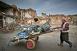 Ahmad Khalil scavenges recyclable metal and plastic from rubble in the old city of Mosul, Iraq. This portion of the city was heavily damaged in 2016 and 2017 when Iraqi forces, supported by U.S. air strikes, combated Islamic State fighters who held residents of the old city as human shields.