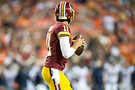 Landover, MD - August 24, 2018: Washington Redskins quarterback Alex Smith (11) drops back to pass during preseason game between the Denver Broncos and Washington Redskins at FedEx Field in Landover, MD. The Broncos defeat the Redskins 29-17. (Photo by Phillip Peters/Media Images International)