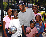 Actor/Comedian Chris Rock has his photo taken with Hurricane Katrina evacuees  while on a visit to the Bonita House in Houston,Texas Thursday Sept. 29,2005.