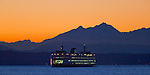 Seattle, WA                               <br /> Washington State ferry on Elliot Bay with Olympic Mts dusk profile