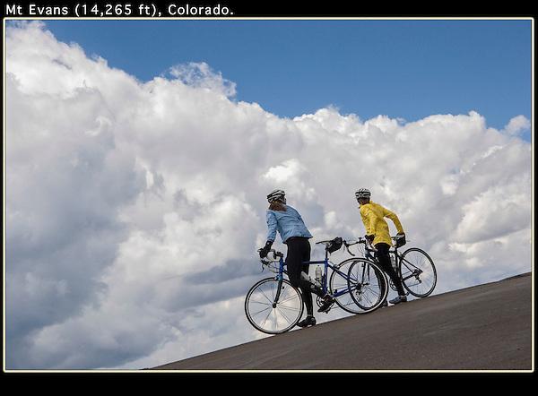 Two women cyclists on Mt Evans Road near Idaho Springs, Colorado.