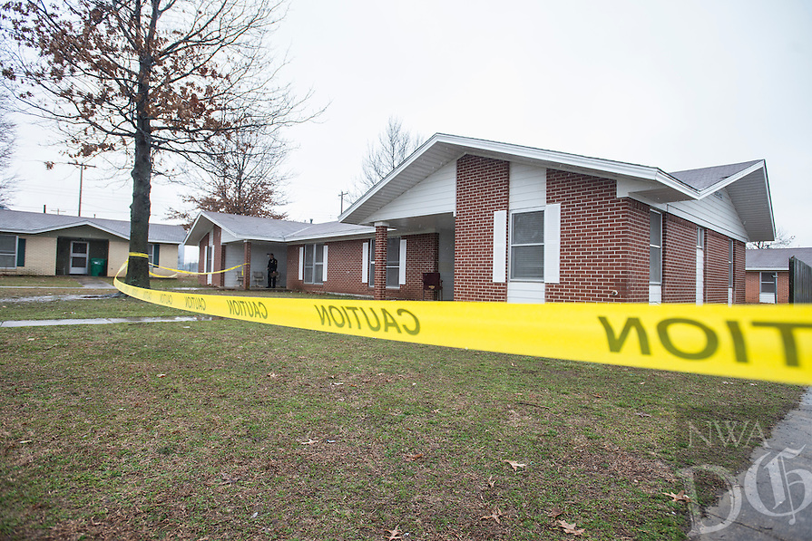 NWA Democrat-Gazette/ANTHONY REYES &bull; @NWATONYR<br /> Springdale police investigate the scene of shooting Friday March 13, 2015 at Applegate Apartments in Springdale. The early morning shooting injured three and killed one.