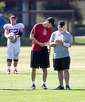 STANFORD, CA - MARCH 7, 2014--Stanford Offensive Assistants Robbie Picazo and Timot Lamarre, during  Open Football Practices at Stanford University.