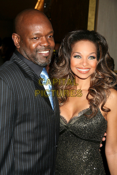 EMMITT SMITH & PATRICIA SOUTHALL.The 8th Annual Family Television Awards at the Beverly Hilton Hotel, Beverly Hills, California, USA..November 29th, 2006.half length black blue pinstripe.CAP/ADM/BP.©Byron Purvis/AdMedia/Capital Pictures