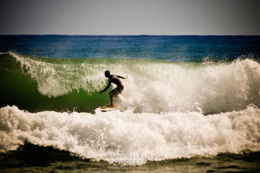 Surfing at Kealia Beach, Kauai, Hawaii