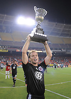 DC United defender Bryan Namoff (26) holds the Atlantic Cup Trophy as they win it at the end of the match , DC United tied The New York Red Bulls 0-0, at RFK Stadium in Washington DC, Saturday August 30, 2008.
