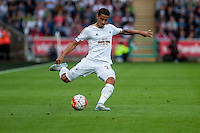 Kyle Naughton of Swansea in action  during the Barclays Premier League match between Swansea City and Everton played at the Liberty Stadium, Swansea  on September 19th 2015