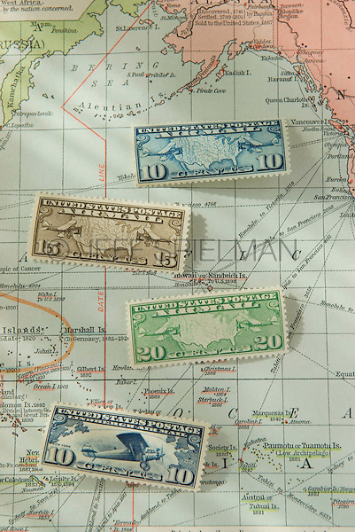 Old United States Airmail Postage Stamps and 1930 World Map<br />