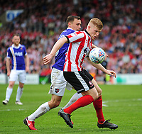 Lincoln City's Elliott Whitehouse shields the ball from Exeter City's Jordan Tillson<br /> <br /> Photographer Andrew Vaughan/CameraSport<br /> <br /> The EFL Sky Bet League Two Play Off First Leg - Lincoln City v Exeter City - Saturday 12th May 2018 - Sincil Bank - Lincoln<br /> <br /> World Copyright &copy; 2018 CameraSport. All rights reserved. 43 Linden Ave. Countesthorpe. Leicester. England. LE8 5PG - Tel: +44 (0) 116 277 4147 - admin@camerasport.com - www.camerasport.com