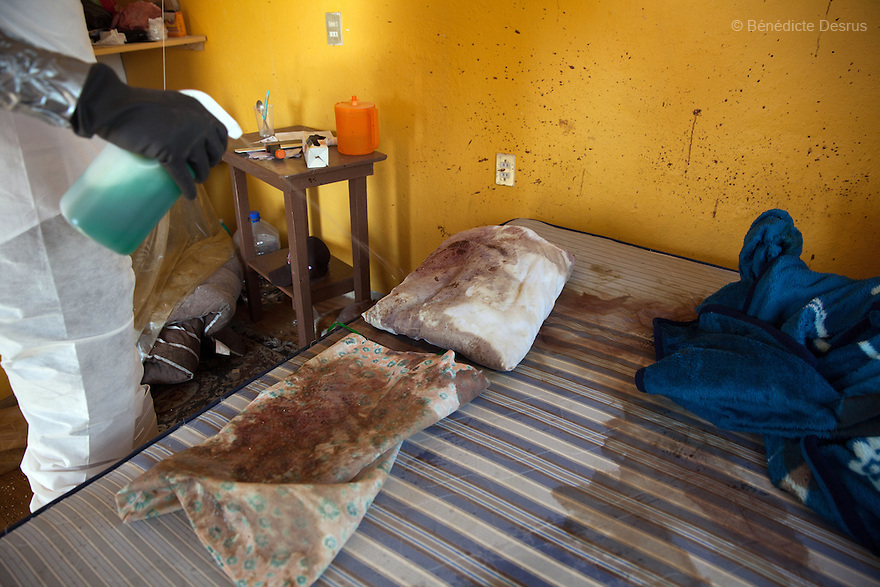 """Donovan using one of the 370 customized formulas which he has devised to carry out the forensic cleaning of the scene of an unsolved homicide in Cuernavaca, Morelos – one of Mexico's most dangerous cities on August 7, 2015. The 66-year-old victim was a retired economics lecturer from the local university, and was killed in January of this year. The cleanup took place eight months later. The victim's family has since moved away to avoid further trouble. They remarked that justice is slow in Mexico and expressed dissatisfaction with the police investigation, but appreciated Donovan's discretion and professionalism. Donovan Tavera, 43, is the director of """"Limpieza Forense México"""", the country's first and so far the only government-accredited forensic cleaning company. Since 2000, Tavera, a self-taught forensic technician, and his family have offered services to clean up homicides, unattended death, suicides, the homes of compulsive hoarders and houses destroyed by fire or flooding. Despite rising violence that has left 70,000 people dead and 23,000 disappeared since 2006, Mexico has only one certified forensic cleaner. As a consequence, the biological hazards associated with crime scenes are going unchecked all around the country. Photo by Bénédicte Desrus"""
